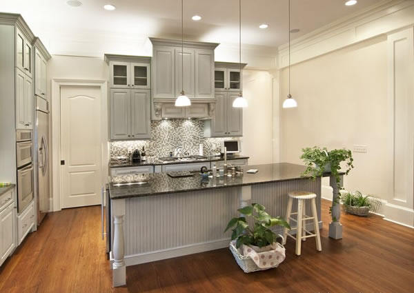 Choosing cabinet paint colors gray or creamy white for Gray kitchen cabinets with black counter