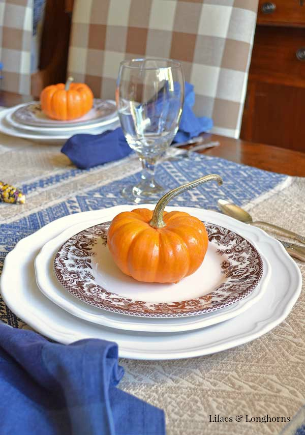 blue brown and orange fall tablescape / Lilacs and Longhorns